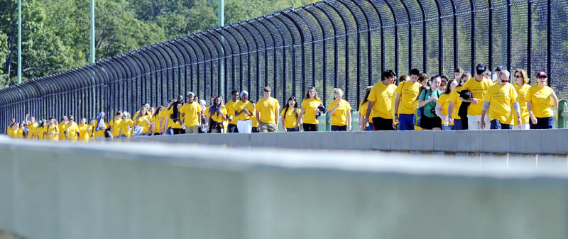 Volunteers walk across Memorial Bridge Sunday in Augusta during a fundraiser for Seeds of Peace, an international non-profit that brings together young people from around the world in the name of peace.