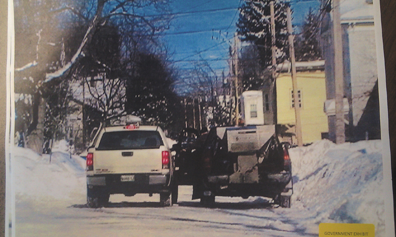 This photo taken by Kennebec County Sheriff's Office Sgt. (now Deputy Chief) Ryan Reardon on Feb. 3, 2011, on Chapel Street in Augusta, Carole Swan's white pickup is shown next to Frank Monroe's plow/sand truck. Monroe is leaning out of the driver's side of the door during the alleged payoff.
