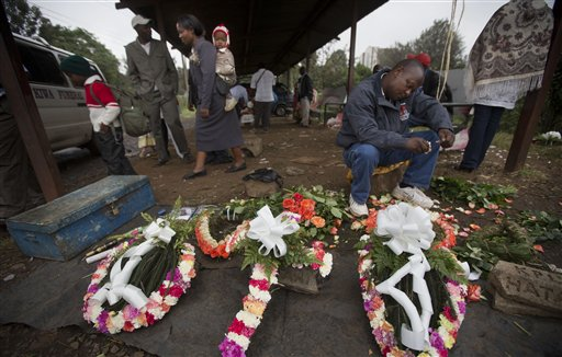 A street trader makes floral wreaths outside the mortuary in Nairobi, Kenya, on Wednesday. On Friday, Karen Wambui identified her son as the last person to be confirmed killed during the Sept. 21, al-Shabab terrorist assault on the Westgate Mall in Nairobi, Kenya.