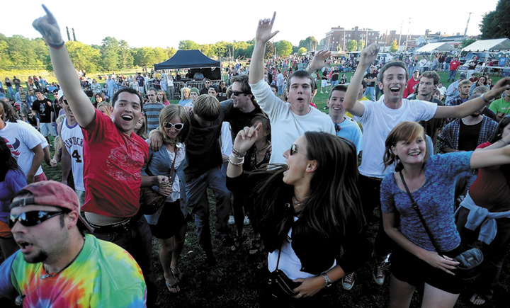 Fans dance to the musical styling of Rustic Overtones at a past Hill 'n the Ville Music Festival at the Head of Falls on Front Street in Downtown Waterville.