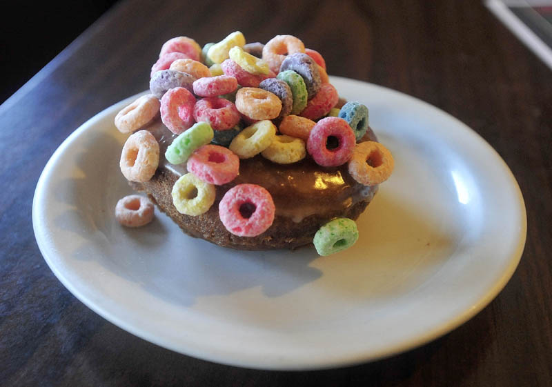 The Cereal Killer doughnut, one of 116 different types of doughnuts offered at Ann and John Maglaras' Kennebec Cafe on Main Street in Fairfield.