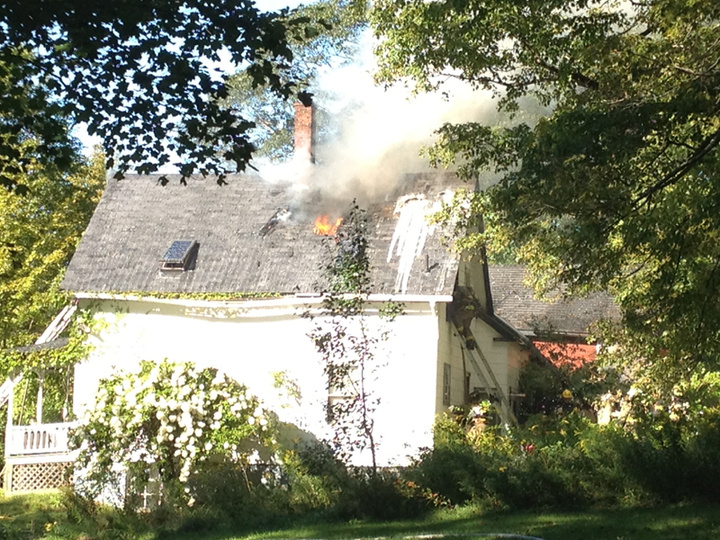 Firefighters battle a blaze at a home near the intersection of Webb Road and Route 126 in Pittston Friday afternoon.