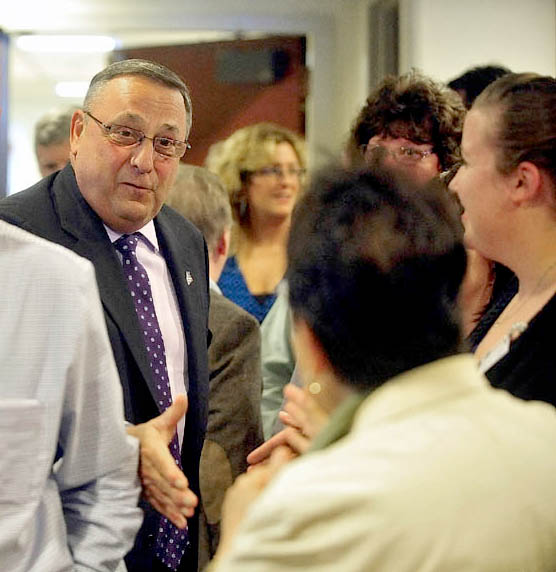 Gov. Paul LePage shakes hands with hospital employees during a press conference at Inland Hospital in Waterville on Wednesday. LePage made the appearance to announce repayment of state MaineCare debt to Maine's 39 hospitals, including $9.5 million to Inland Hospital.
