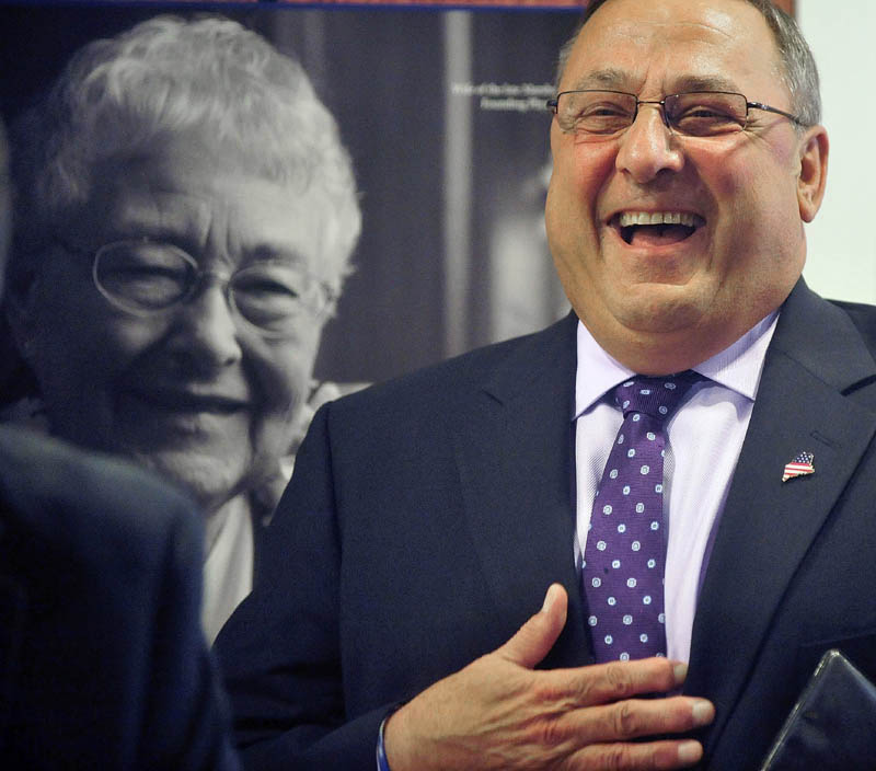 Gov. Paul LePage laughs as he is introduced by John Dalton, president and CEO of Inland Hospital, during a press conference at the hospital in Waterville on Wednesday. LePage made the appearance to announce repayment of state MaineCare debt to Maine's 39 hospitals, including $9.5 million to Inland Hospital.