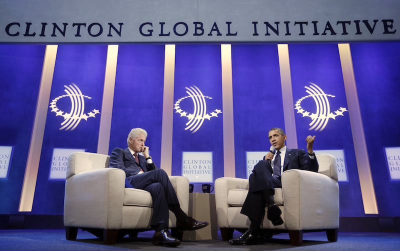 President Barack Obama, right, with former President Bill Clinton, left, speaks at the Clinton Global Initiative in New York, Tuesday, Sept. 24, 2013.