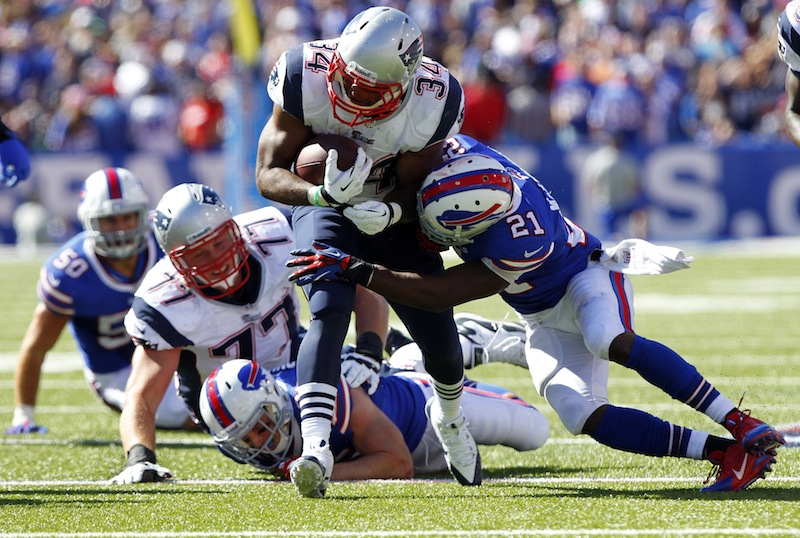 Buffalo Bills cornerback Leodis McKelvin (21) tackles New England Patriots' Shane Vereen (34) during the second half of an NFL football game on Sunday, Sept. 8, 2013, in Orchard Park. (AP Photo/Bill Wippert)