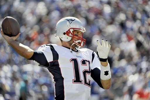 New England Patriots quarterback Tom Brady warms up along the sidelines at halftime during an NFL season opener against the Buffalo Bills Sunday, Aug. 8, 2013, in Orchard Park. (AP Photo/Gary Wiepert)