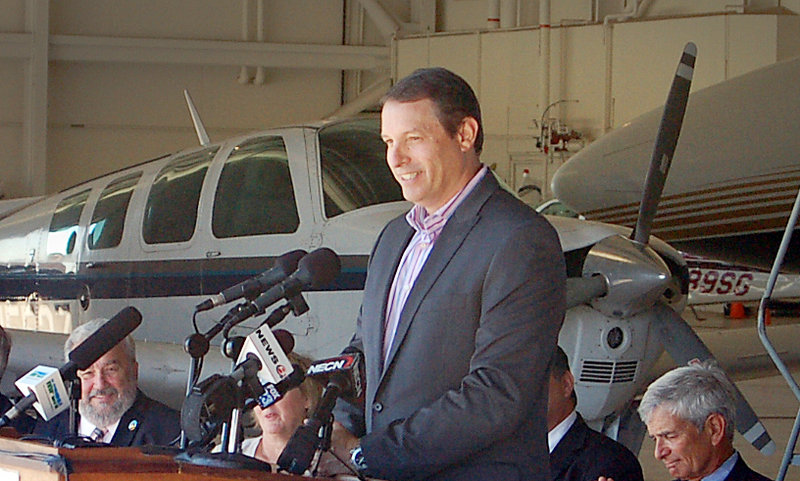 Tempus Jets CEO Scott Terry speaks at a press conference at the former Brunswick Naval air station on Wednesday, Sept. 4, 2013, where Tempus will relocate part of its business.