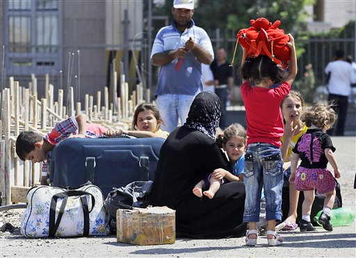 Syrian refugees arrive at the Turkish Cilvegozu gate border today. Routine prevailed at a U.S.-Turkish airbase in southern Turkey on Monday, a day after the U.S. alleged that sarin gas was used in an August chemical weapons attack in Syria.