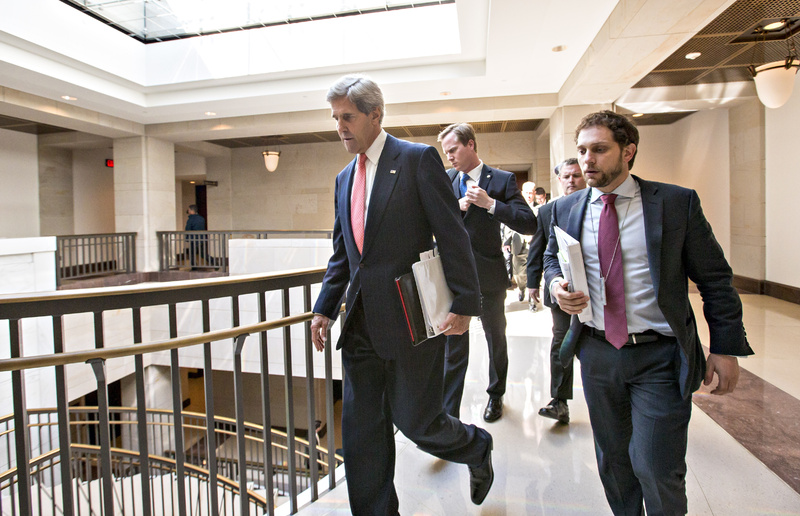 Secretary of State John Kerry arrives at the Capitol for a closed-door briefing on Syria with members of the Senate Foreign Relations Committee in Washington on Tuesday.