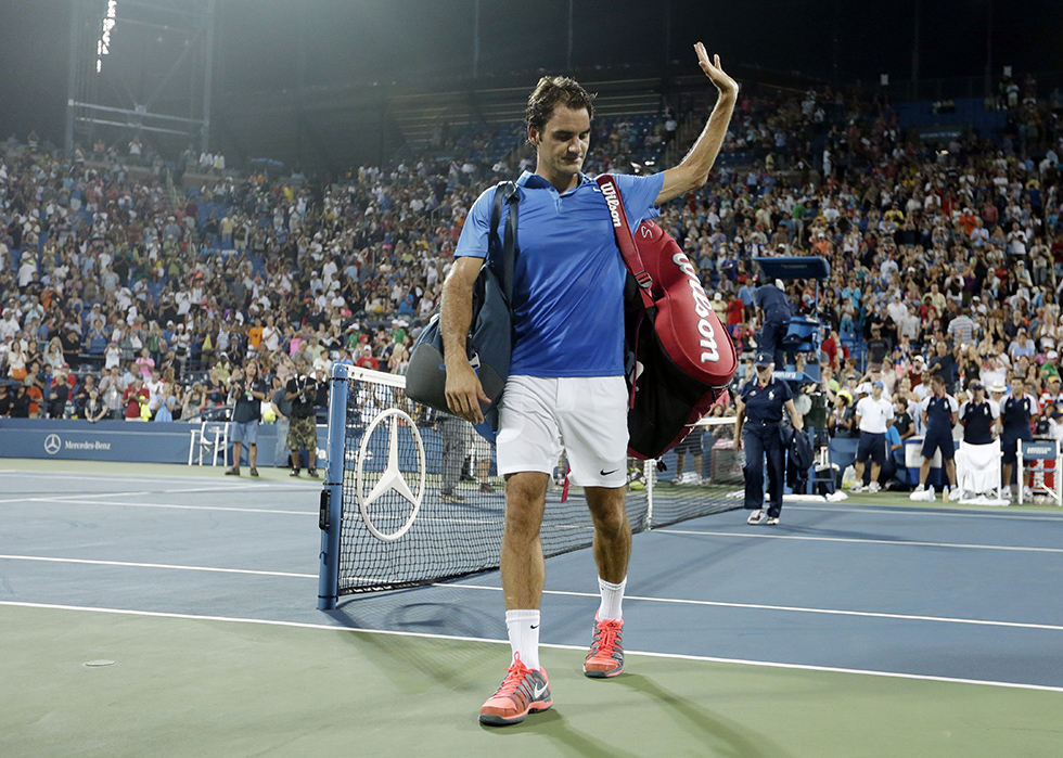 Roger Federer, of Switzerland, walks off the court after losing in straight sets to Tommy Robredo, of Spain, during the fourth round of the 2013 U.S. Open tennis tournament, Monday, Sept. 2, 2013, in New York. (AP Photo/Darron Cummings)