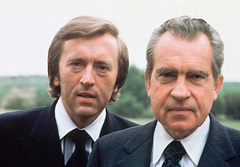 Former U.S. President Richard M. Nixon, right, with broadcaster David Frost in California in 1977. Frost died Saturday night at the age of 74, his family said in a statement on Sunday.