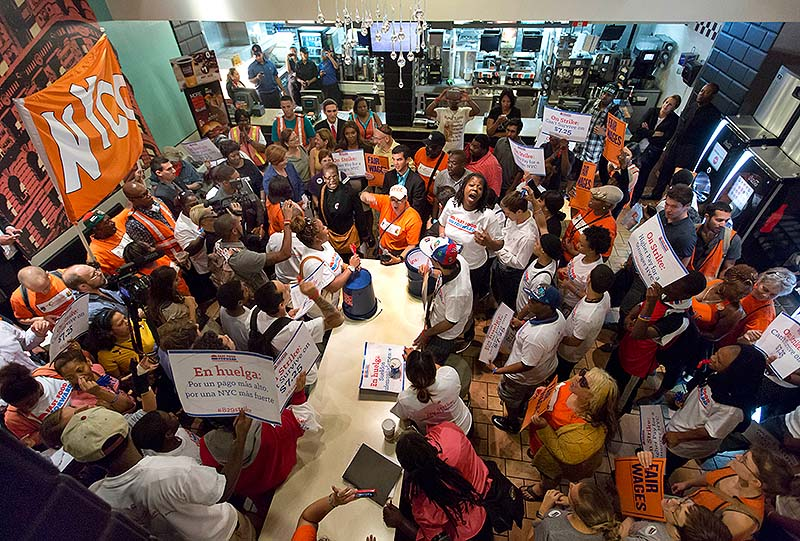 Protesting fast-food workers fill a McDonald's restaurant on New York's Fifth Avenue last Thursday. Thousands of fast-food workers and their supporters have been staging protests across the country to call attention to the struggles of living on or close to the federal minimum wage. The push raises the question of whether the economics of the fast-food industry allow room for a boost in pay for its workers.