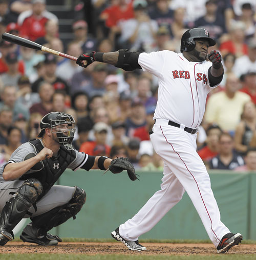 BIG HITTER: Boston's David Ortiz, right, hits an RBI double off a pitch by Chicago White Sox pitcher Andre Rienzo as catcher Tyler Flowers looks on in the second inning Sunday at Fenway Park, in Boston.