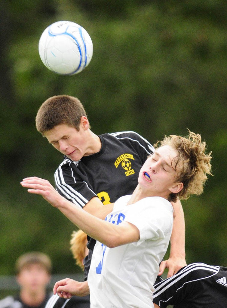 SMASH: Maranacook's Kent Mohlar, left, and Erskine's Phoenix Throckmorton go up for a header during a game Tuesday at Erskine Academy in South China.