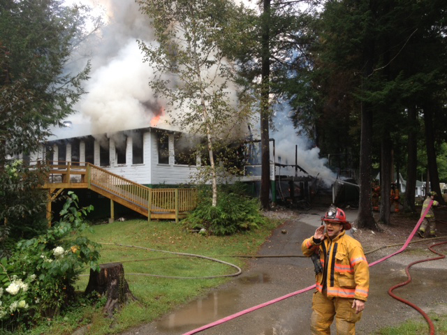 The lodge at Echo Lake camp in Fayette was fully engulfed upon the arrival of firefighters, according to Readfield Fire Chief Lee Mank.