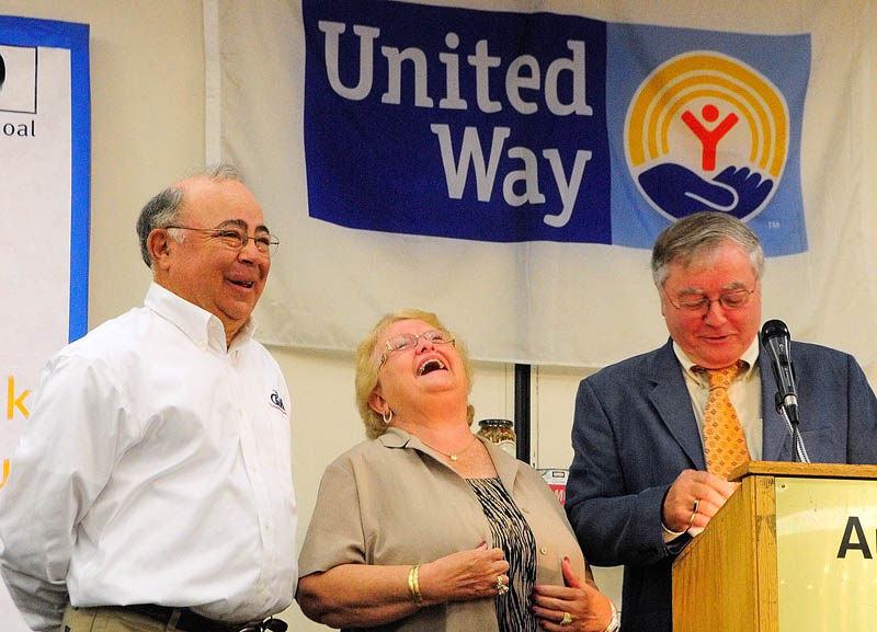Charlie and Nancy Shuman laugh at something Rob Gordon, executive director of the United Way of Kennebec Valley, said while presenting them the Norm Temple Award on Wednesday during the United Way of Kennebec Valley breakfast event at the Augusta Civic Center.