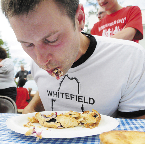 Tyler Pope, 32 of Whitefield, won the pie-eating contest during Whitefield Community Day today in Whitefield. Pope was the fastest of four contestants to eat three Table Talk pies without using his hands. His prize was a full-sized pie from The Chase Farm Bakery.