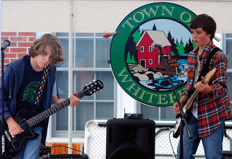 Milo Lani-Caputo, left, and Connor McLean, billed as Double Jinx, perform during Whitefield Community Day today in Whitefield.
