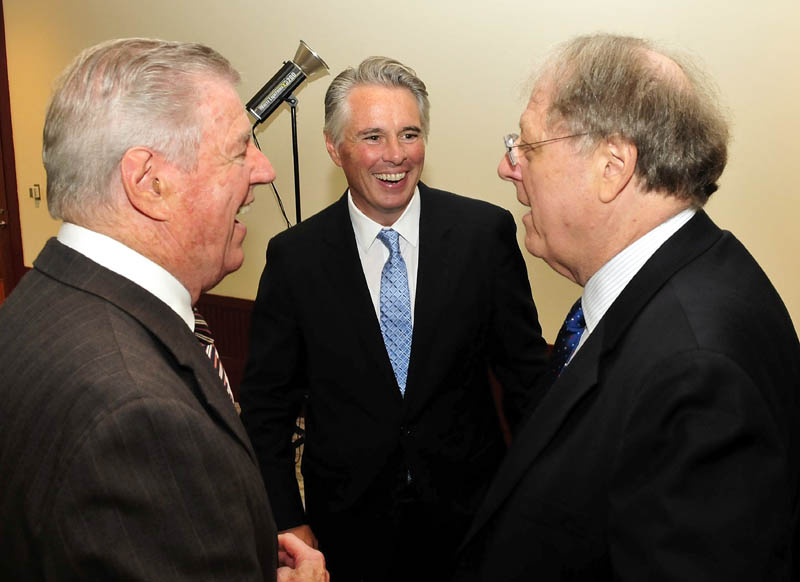 David A. Greene, center, has been named the next president of Colby College in Waterville. Greene is chatting with his father, Richard Greene, left, and Michael Gordon, chairman of Colby College's president search committee, during a reception today in Waterville.