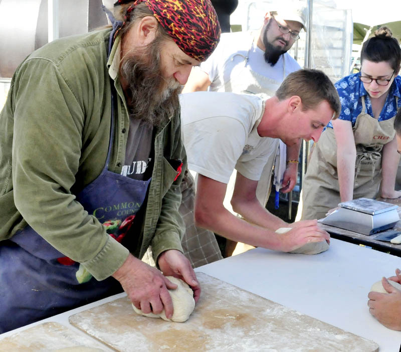 Dusty Dowse, left, and other bakers prepare dough Thursday for 500 loaves of rye bread to feed volunteers at the upcoming three-day Common Ground Country Fair in Unity. Others making bread, from left, are: Jeff Dec, Lily Joslin and Dan Rivera, in background.