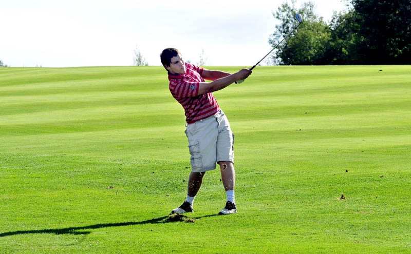 SWING AWAY: Messalonskee's Kalib Bernatchez watches his drive in a match against Waterville on Monday at Belgrade Lakes Golf Course in Belgrade. Bernatchez shot a 46 on the par-35 course.