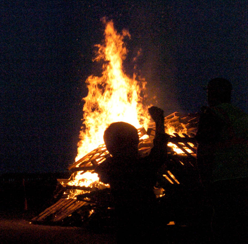 Waterville students celebrate tonight night with a bonfire and pep rally at Head of Falls before homecomng events Saturday. Isiah Vear, 7, was there with his family.