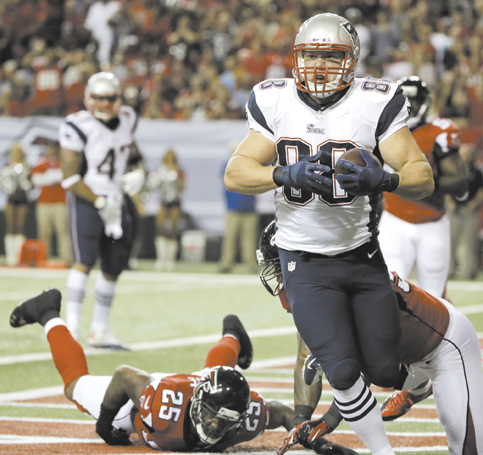 MAINE MAN: New England Patriots tight end Matthew Mulligan (88) catches touchdown pass against the Atlanta Falcons on Sunday in Atlanta. Mulligan, a West Enfield native, now has two touchdowns receptions in his NFL career. NFLACTION13; Georgia Dome