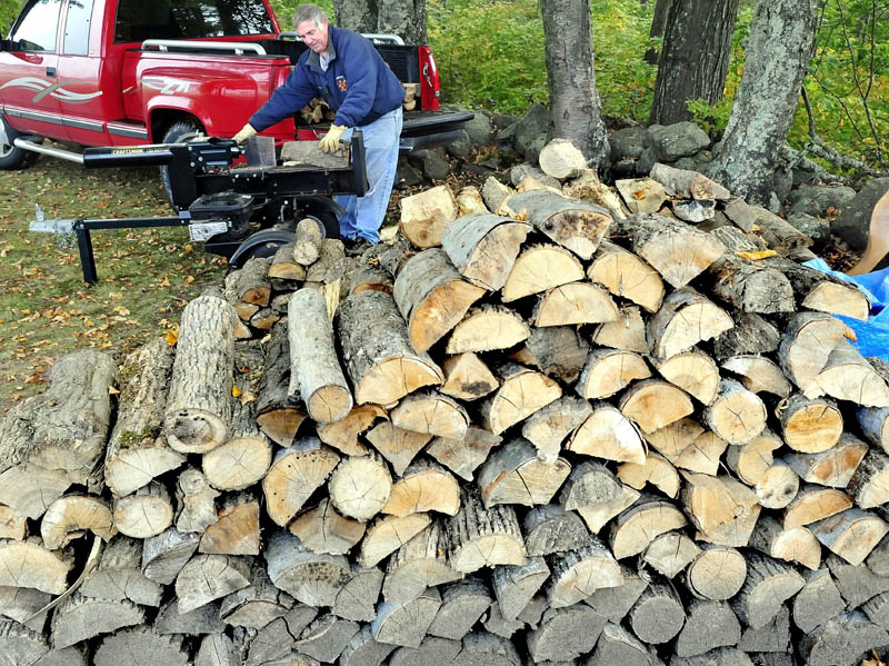 Doug Oliver splits firewood in Farmington today. Many homeowners are busy getting their wood supply indoors as winter never seems too far away in Maine.