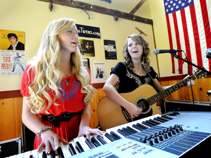 Identical twins Katherine, left, and Kristen Veayo, 18, play a song at their home in Winthrop. Music became their biggest source of comfort after years of being bullied.