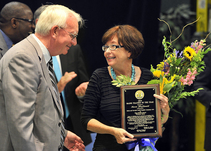 Teacher Karen MacDonald shares a moment with Middle School Principle Michael McCarthy after she was named Maine Teacher of the Year on Tuesday, Sept. 10, 2013 at an assembly at King Middle School in Portland.