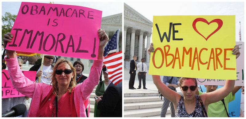 An opponent, left, and a supporter, right, of Obamacare hold placards as they rally in front of the Supreme Court in Washington in March.