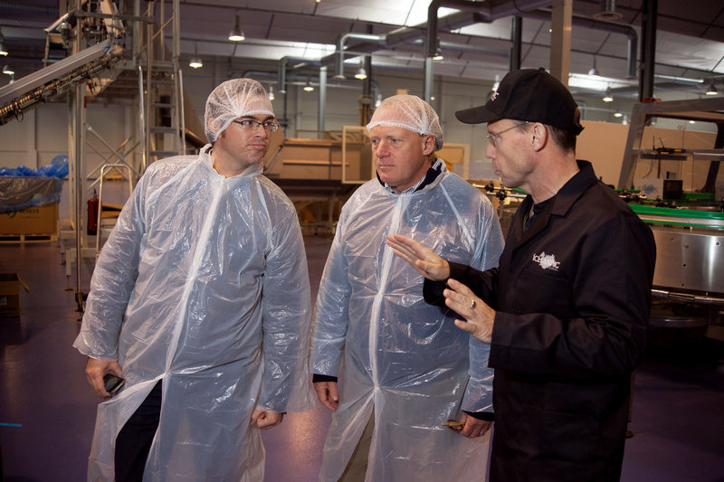 Patrick Arnold, left, and John Henshaw, center, of the Maine Port Authority listen to Tryggvi Hardarson, plant manager of the water-bottler that produces Icelandic Glacial, earlier this month. Officials in Maine and Iceland alike seem determined to build relationships and make a blossoming trade partnership work.