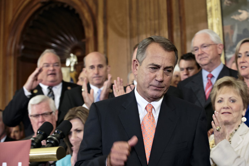 House Speaker John Boehner, R-Ohio, and Republican House members rally after passing a bill that would fund the government for three months while crippling Obamacare.