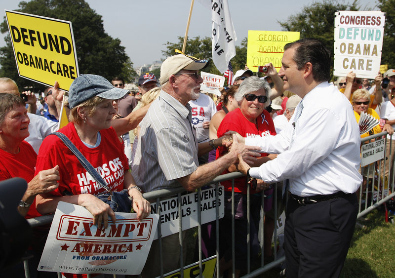 Sen. Ted Cruz greets attendees as he arrives to speak at the Exempt America from Obamacare rally on the west lawn of the U.S. Capitol in Washington on Sept. 10.