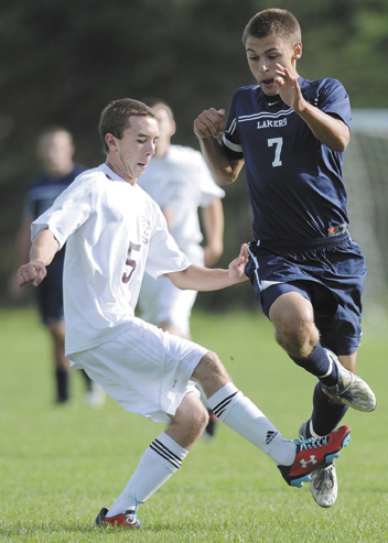 TRIPPED UP: Richmond High School's Sean Bernier, left, and Greenville High School's Matt DiAngelo get tangled up during the Bobcats 3-0 win Monday in Richmond. Monday during a soccer match up in Richmond.