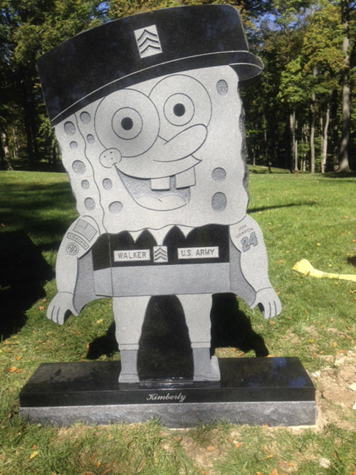 This Oct. 10, 2013, photo provided by the family of Kimberly Walker shows Walker's gravestone in the likeness of popular cartoon character SpongeBob SquarePants. Spring Grove Cemetery in Cincinnati recently removed it, saying it did not fit in with the character of the historic and picturesque cemetery.
