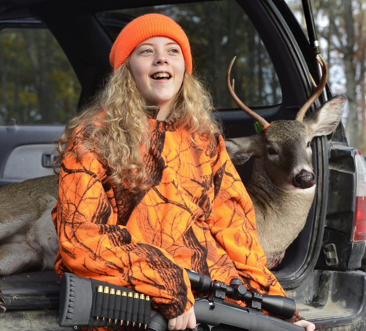 Anna Scamman, 13, of Standish recalls getting up early with her mother, Nichelle Scamman, to harvest this five-point buck on Youth Deer Hunting Day. She joined others tagging their deer at Jordan's Store in Sebago.