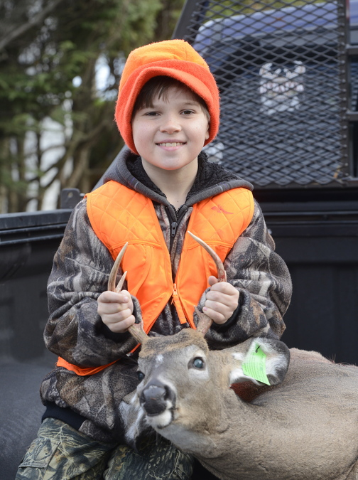 Jordan Day, 10, from Westbrook bagged this small buck with his stepfather, James Tucker, on Youth Deer Hunting Day on Saturday.