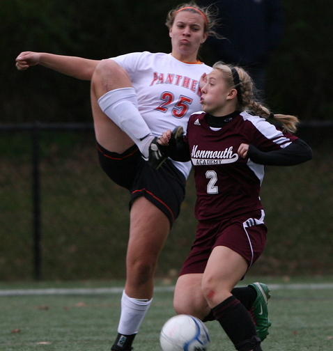 Haley Fletcher, right, of Monmouth Academy tries to shield the ball away from North Yarmouth Academy's Mary Noyes.