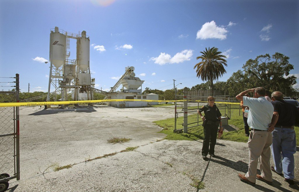 The Associated Press FILE - In this Sept. 10, 2013 file photo, Polk County Sheriff personnel investigate the death of 12-year-old girl, Rebecca Ann Sedwick, at an old cement plant in Lakeland, Fla. Two girls have been arrested in her death. Officials say she committed suicide after being bullied online for nearly a year. On Tuesday, Oct. 15, 2013 Polk County Sheriff Grady Judd will announce charges against the girls, age 12 and 14, in a press conference.