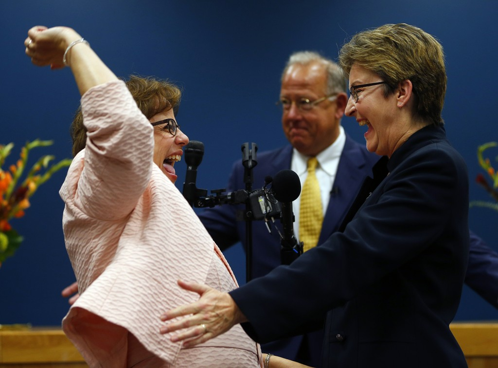 Beth Asaro, left, and Joanne Schailey celebrate after exchanging vows as Lambertville, N.J., Mayor David DelVecchio officiates in the first same-sex marriage in Lambertville history at 12:01 a.m. MondayAsaro and Schailey hold the distinction of being the first couple to enter into a civil union in the state, when that law took effect in 2007.