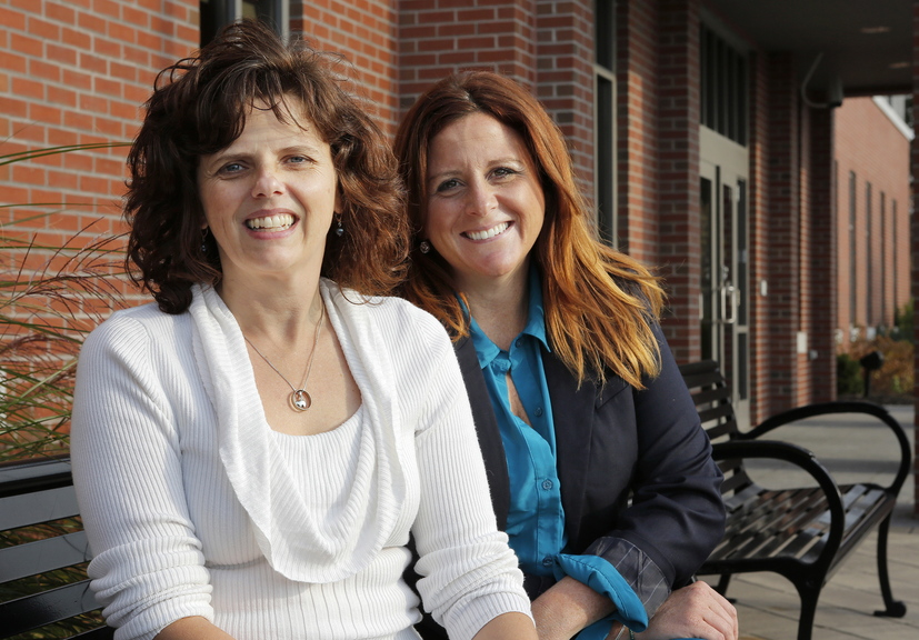 Sara Devlin of South Portland, right, created a Gofundme for Rebecca Grover, left, her co-worker at the Maine Turnpike Authority, after Grover's husband passed away in 2012. In the 11 months since the account was created, 172 people have donated $23,000 to help Grover and her two children.