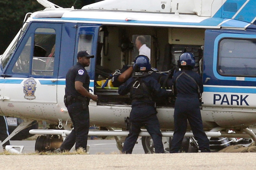 A U.S. Park Police helicopter is loaded with an injured police officer on the Mall in Washington on Thursday.