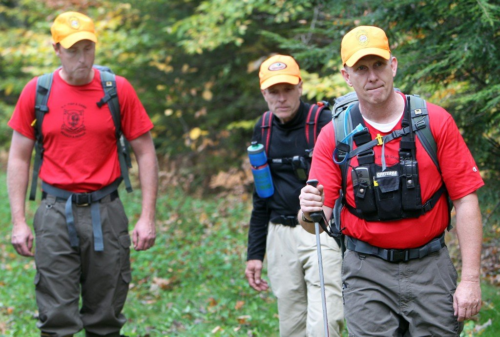 In this photo taken Friday Oct. 11, 2013 in North Conway, N.H., Fish and Game and volunteers head back into the woods looking for 15-year-old Abigail Hernandez. The small tourists town in the White Mountains is still wondering what happened to the teenager who was last seen walking towards home after leaving school on Oct. 9.