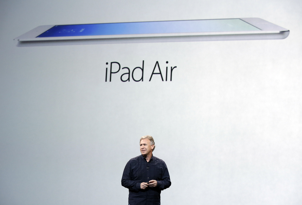 Phil Schiller, Apple's senior vice president of worldwide product marketing, introduces the new iPad Air on Tuesday in San Francisco. Facing an eroding tablet market and growing competition, Apple is slashing prices this holiday season.