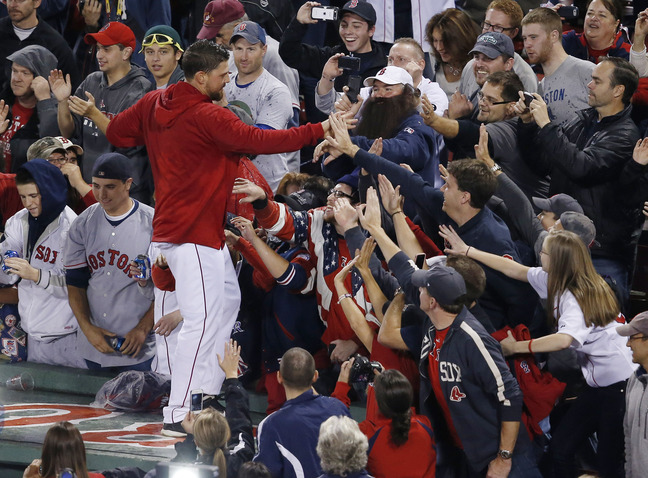 Boston Red Sox catcher Ryan Lavarnway celebrates on the dugout with fans after the Red Sox beat the Detroit Tigers 5-2 in Game 6 of the American League baseball championship series on Saturday in Boston. The Red Sox play the Cardinals in the first game of the World Series on Wednesday.