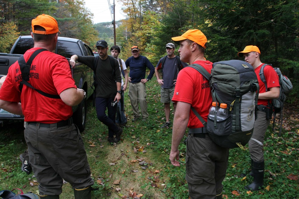 New Hampshire Fish and Game personnel and volunteers get ready to head back into the woods to search for 14-year-old Abigail Hernandez, Friday, Oct. 11, 2013, in North Conway, N.H. Hernandez was last seen Wednesday afternoon leaving school.