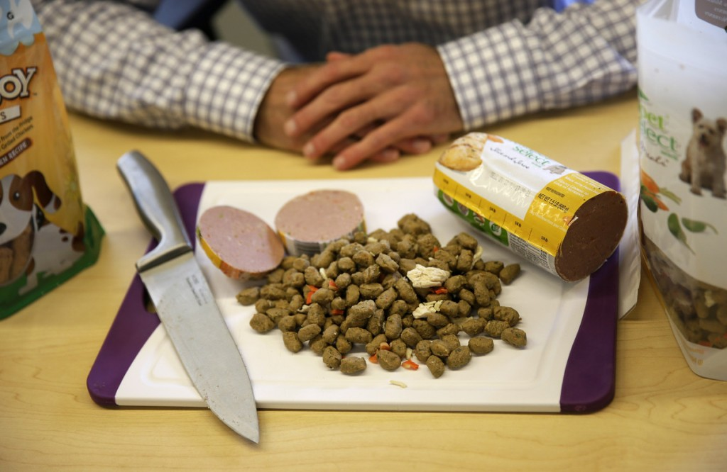 Freshpet co-founder and president Scott Morris talks with an Associated Press reporter over a display of the company's pet food in Bethlehem, Pa.