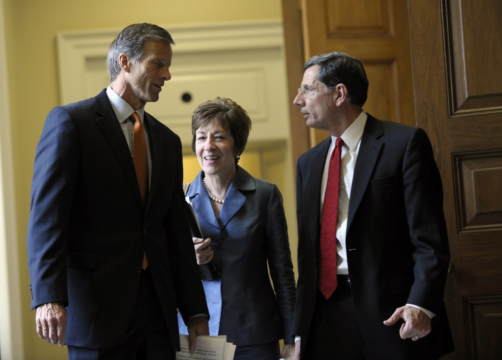 From left, Sen. John Thune, R-S.D., Sen. Susan Collins, R-Maine, and Sen. John Barrasso, R-Wyo., talk as they leave a closed-door meeting of Senate Republicans on Capitol Hill in Washington, Wednesday, Oct. 9, 2013. President Barack Obama is making plans to talk with Republican lawmakers at the White House in the coming days as pressure builds on both sides to resolve their deadlock over the federal debt limit and the partial government shutdown.